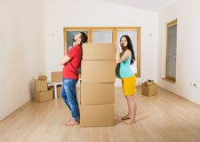 Pregnant mother and happy father in new house Stock Photo