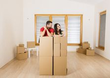 Pregnant mother and happy father in new house Stock Photography
