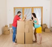 Pregnant mother and happy father in new house Stock Image