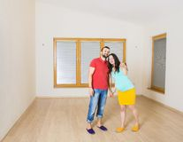 Pregnant mother and happy father in new house Royalty Free Stock Images