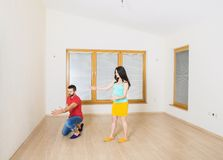 Pregnant mother and happy father in new house Royalty Free Stock Image