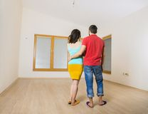 Pregnant mother and happy father in new house Stock Photos
