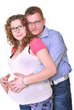 Pregnant mother and happy father. Young attractive couple: pregnant mother and happy father Royalty Free Stock Image