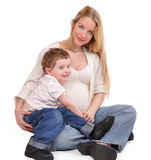 Pregnant Mother and Happy Son Hugging Royalty Free Stock Photo