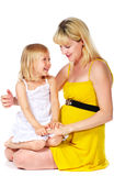 Pregnant mother and her daughter. Laughing Royalty Free Stock Photos