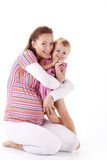 Pregnant mother with her daughter. Pregnant mother with her small daughter studio shot Royalty Free Stock Photography
