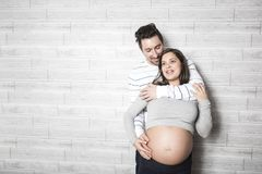 Pregnant Mother and her husband on baby room Stock Image
