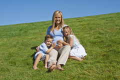 Pregnant Mother with her kids Stock Images
