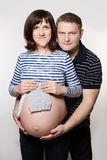 Pregnant Mother and her Man. Couple Waiting a Baby. Real People Stock Photography