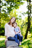 Pregnant mother with her small daughter. Outdoors Royalty Free Stock Image