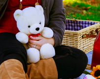 Pregnant mother holds her childs teddy bear. A pregnant mother holds her childs teddy bear Stock Photography