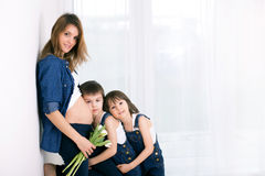 Free Pregnant Mother, Hugging Her Children, Receiving Tulips, Flowers Royalty Free Stock Images - 88978329