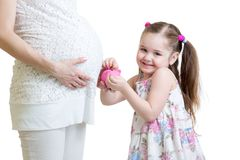 Pregnant mother and kid putting coins into piggy Stock Photography