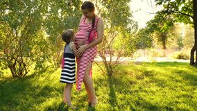 Pregnant mother and little daughter stock video footage