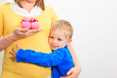 Pregnant mother with little son Stock Photography