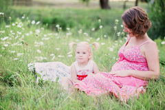 Pregnant mother playing with her daughter Royalty Free Stock Images