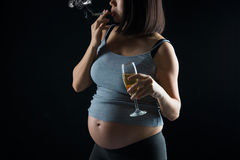 Pregnant mother smoking and drinking Stock Image
