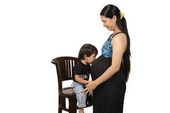 Pregnant Mother And Son. Pregnant mother and her son isolated over white background Stock Photos