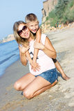 Pregnant mother and son hugging and smiling Stock Photo