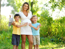 Pregnant mother with two sons Royalty Free Stock Photo