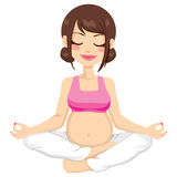 Pregnant Mother Yoga Pose. Beautiful young pregnant woman practicing yoga pose Stock Photo