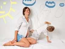 Pregnant mom and son royalty free stock photography