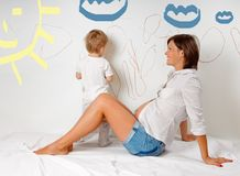 Pregnant mom and son Royalty Free Stock Image