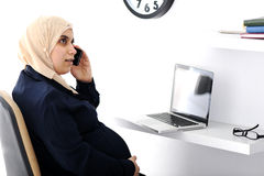 Pregnant Muslim Arabic business woman. Speaking on phone Royalty Free Stock Photo