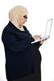Pregnant Muslim Arabic woman. Using laptop Stock Photo