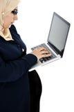 Pregnant Muslim Arabic woman. Using laptop Stock Image