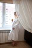 Pregnant near window Royalty Free Stock Photo