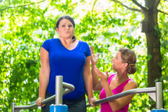 Pregnant and obese woman during workout. Pregnant and obese women during workout Stock Photos