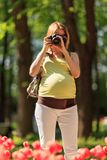 Pregnant photographer Royalty Free Stock Photo