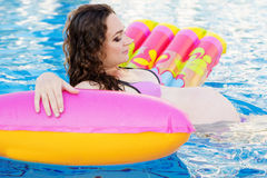 Pregnant pretty girl is swimming in pool Stock Photo