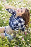 Pregnant pretty woman on field with daisy flowers Stock Images