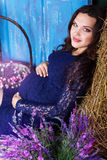 Pregnant pretty woman with hay and flowers Royalty Free Stock Photos