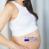 Pregnant with a progressbar on her belly Stock Images