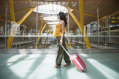 Pregnant Pulling Suitcase Inside Airport Royalty Free Stock Image