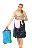 Pregnant purchased baby cloth Stock Images
