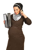 Pregnant  receive bad news by phone Stock Image