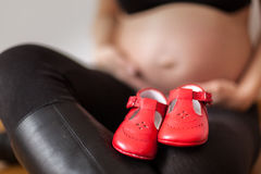 Pregnant red shoes Royalty Free Stock Images