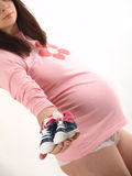 Pregnant with shoe Stock Images
