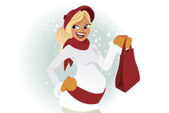 Pregnant shopper in winter. Holding a shopping bag Stock Images