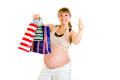 Pregnant with shopping bags showing thumbs up Royalty Free Stock Images