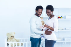 Pregnant showing baby shoes to husband Royalty Free Stock Photography