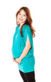 A pregnant smiling young woman Stock Photography