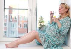 Pregnant soap blowing bubbles Stock Photography