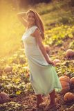Pregnant is something that every woman wants. Happy pregnant woman standing on field with pumpkin. Copy space Stock Photography