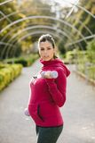 Pregnant sporty woman exercising using weights outdoor. Fitness pregnant woman exercising with dumbbells. Gravid female athlete working out biceps outdoor at Stock Image