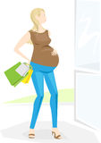 Pregnant stylish woman goes shopping. Relaxing outside, feels tired Royalty Free Stock Image